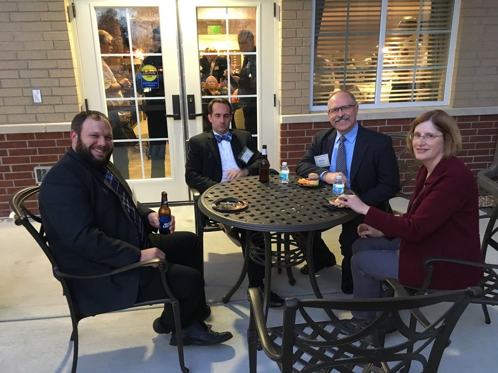 Todd (in his spiffy band suit), Pete (in a cocktail-shrimp-induced coma), and Merlin & his lovely wife, Susan all enjoy some outdoor seating at Westbrook Senior Living.