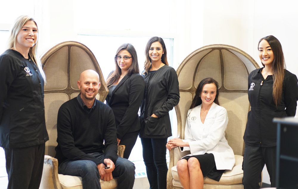 Staff photo of Gentry Dentistry including Dr. Gentry, hygienists, dental assistant and front office managers