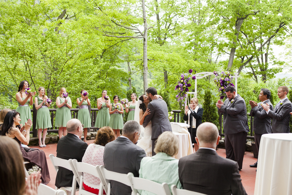 bride and groom have first kiss