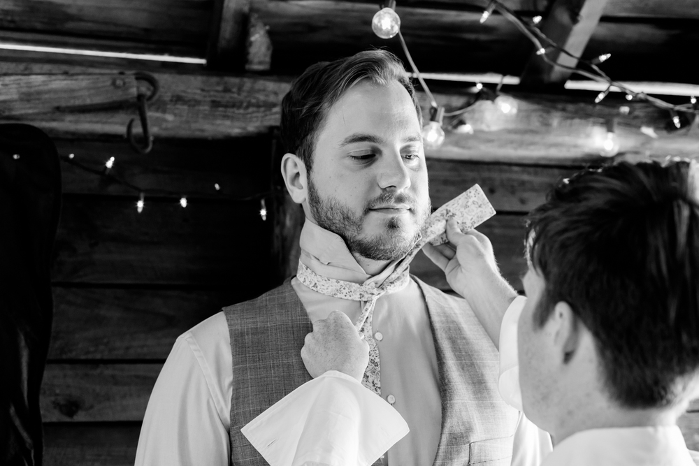 groom get's his bow tie put on.