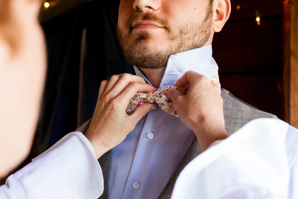 A close up of the grooms bow tie.