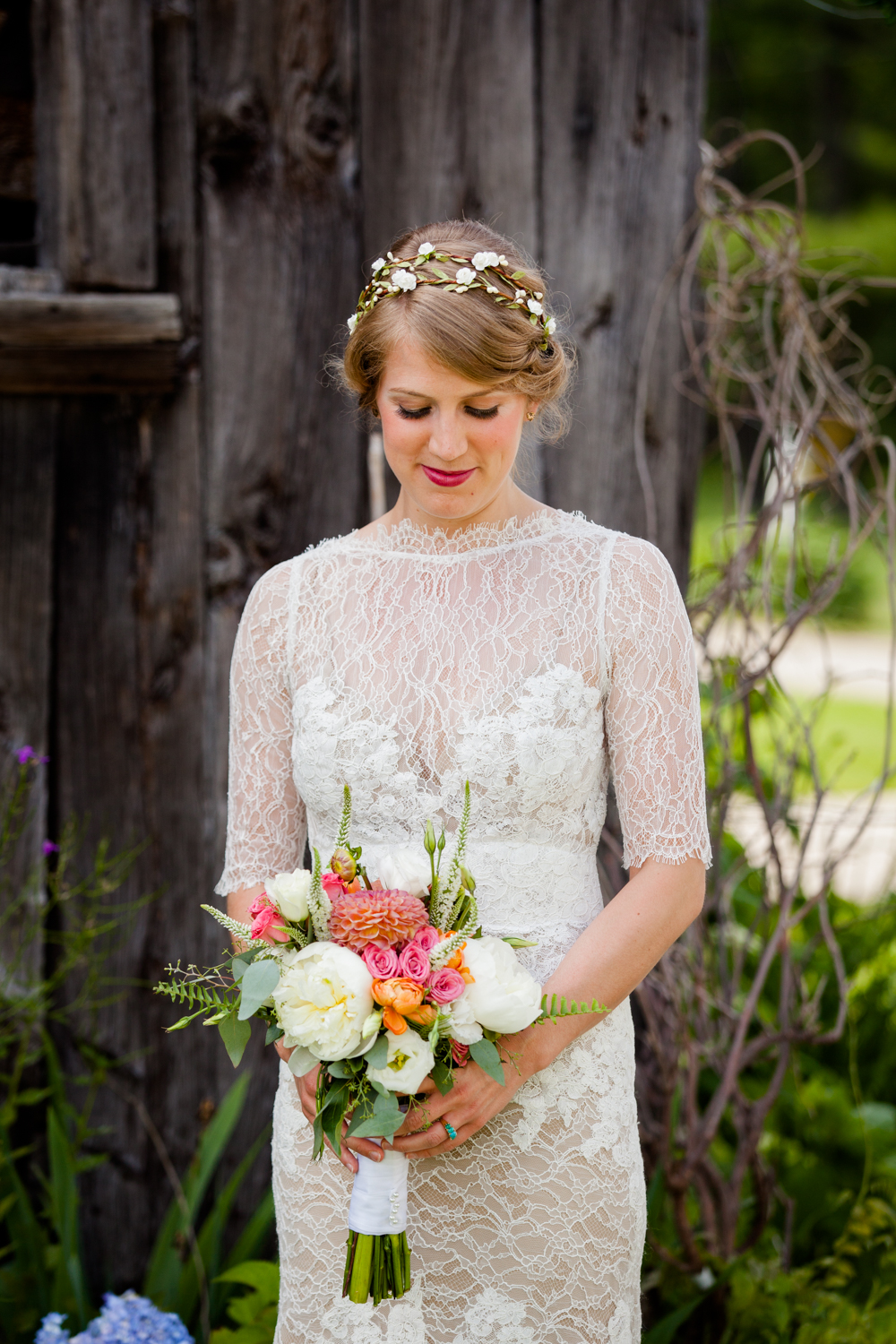 A beautiful bride gazes at her flowers