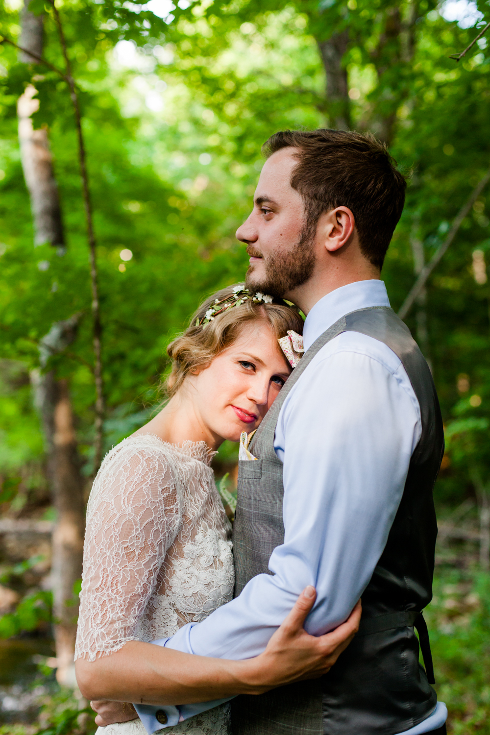 A close up of the bride and groom in the Adirondack woods