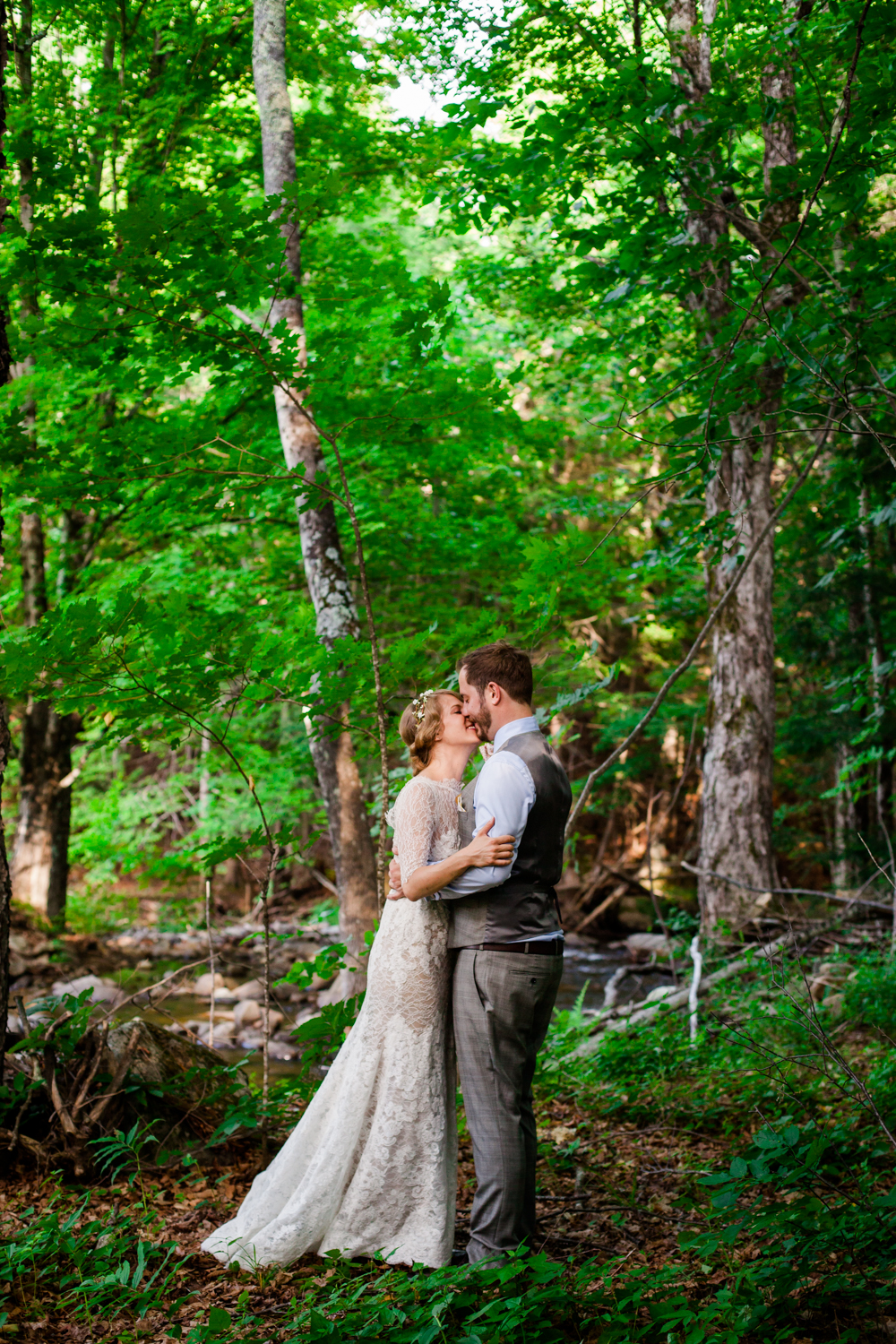 Bride and groom share a moment in the Adirondacks