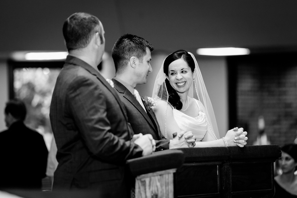 Bride smiles at groom during ceremony