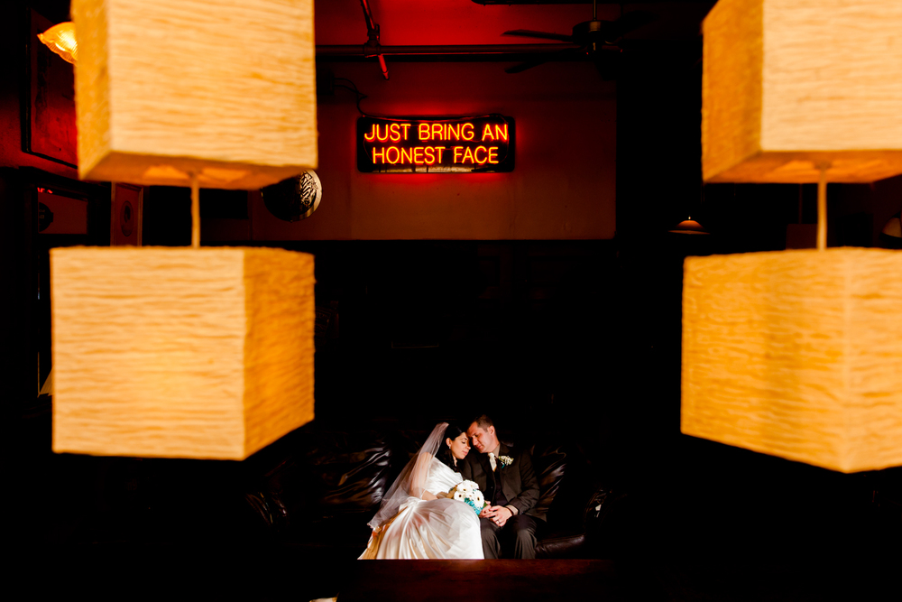 Gorgeous portrait of the bride and groom at Al's Wine and Whiskey Lounge in the historic Armory Square.