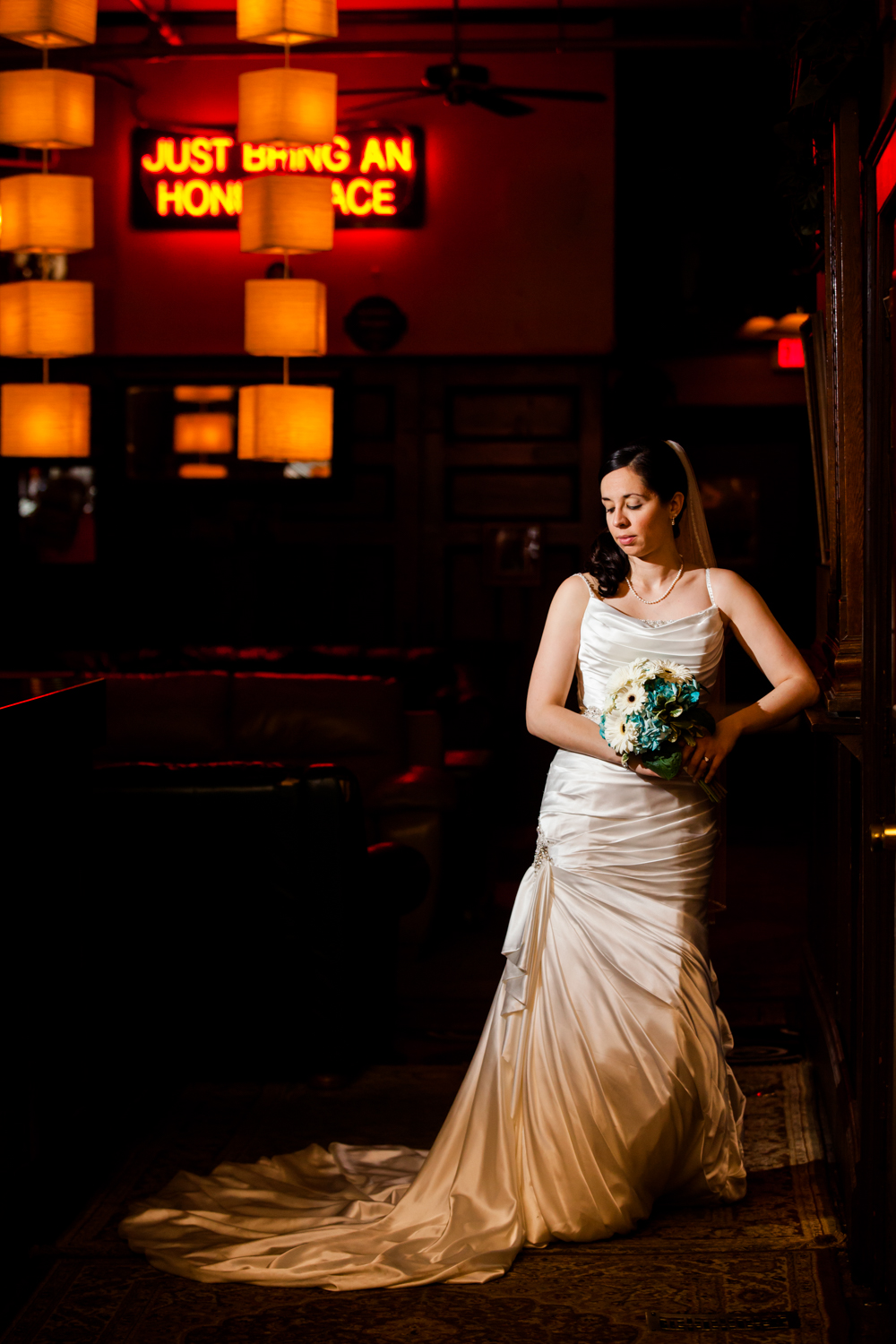 Full length photograph of a bride in a Davinci gown.