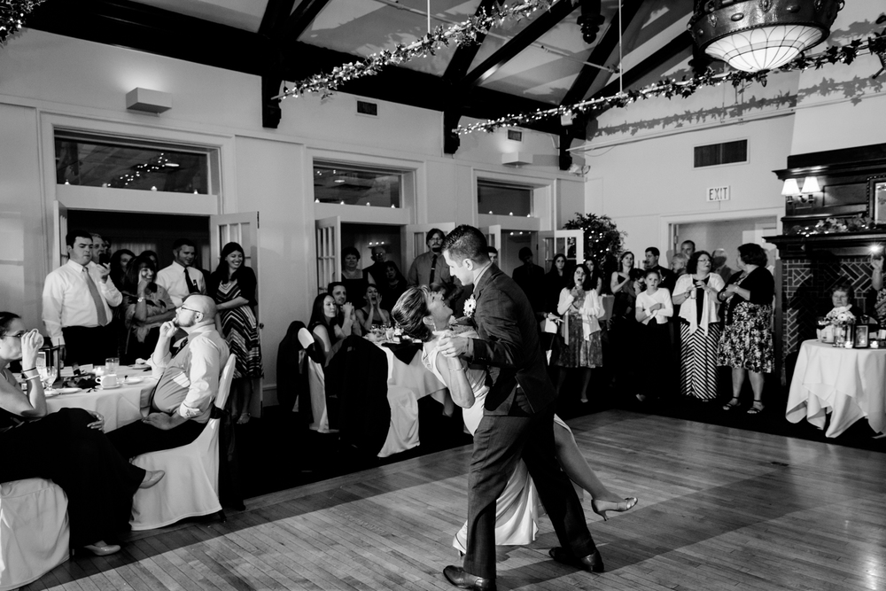 Groom dips his mother while dancing
