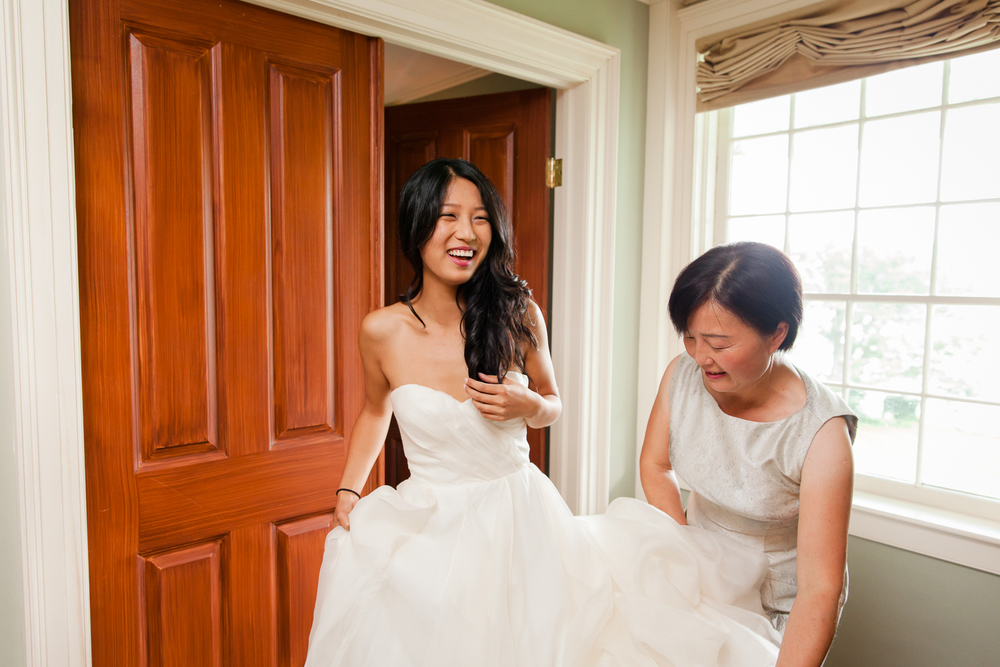 Bride shows off wedding gown.