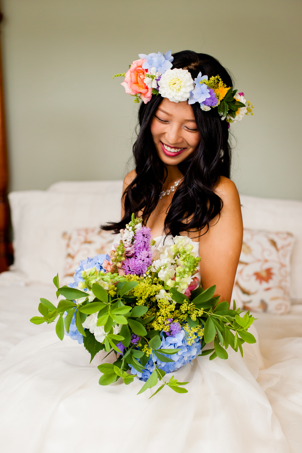 bride with flowers by Syracuse wedding photography