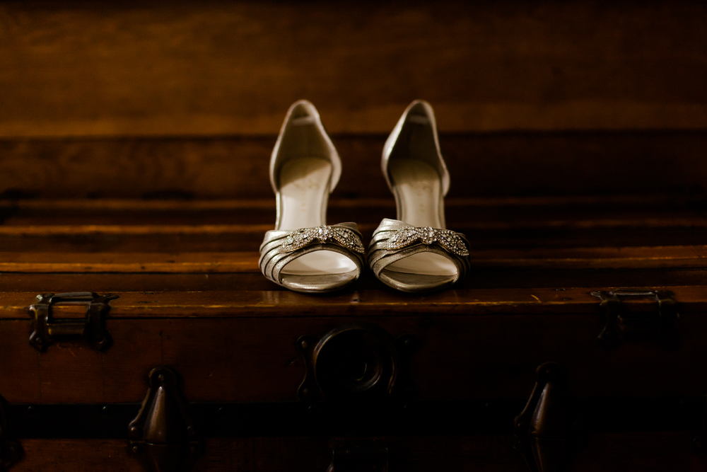 wedding shoes sit on a wooden chest