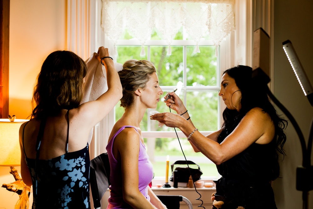 Bride gets her makeup done at the Frog Pond bed and breakfast