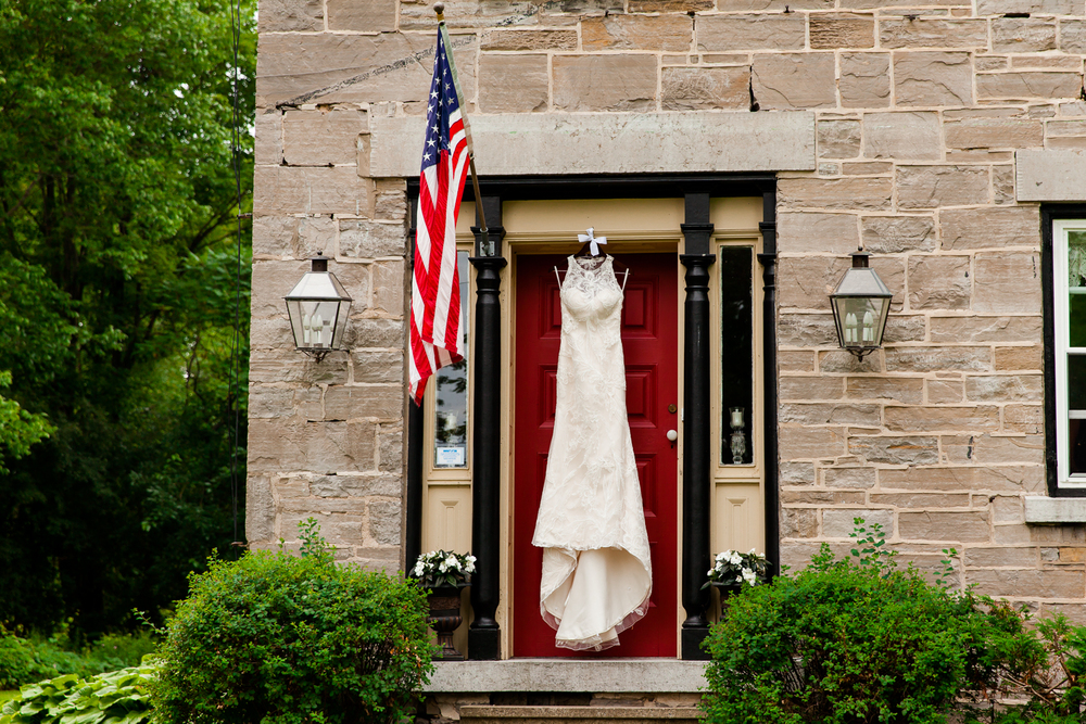 White wedding gown hangs on the Frog Pond bed and breakfast in Skaneateles, NY.