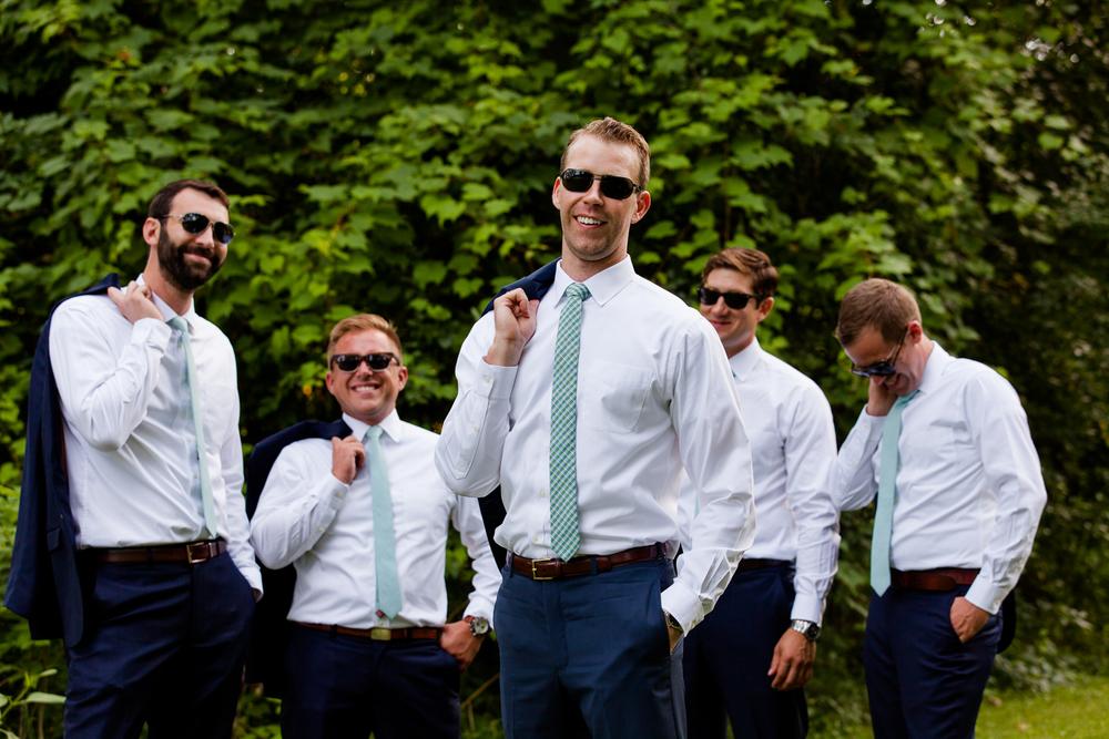 Groomsmen wearing sunglasses.