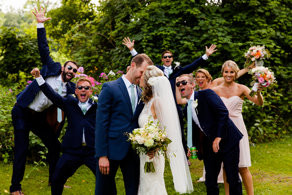 Bride and groom get photobombed by bridal party.