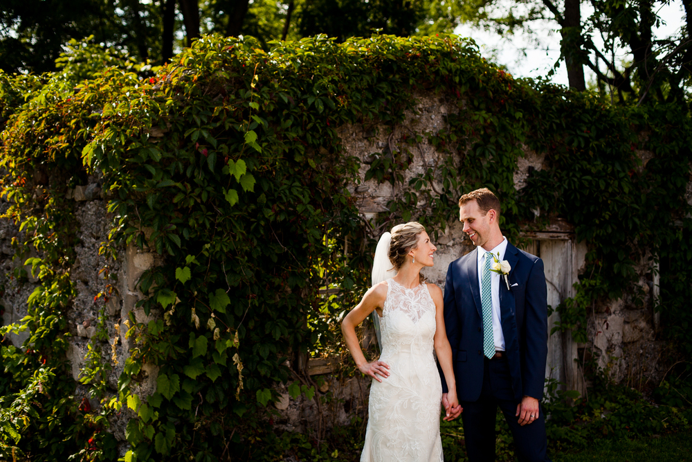 The bride and groom by the ruins at the Frog Pond Bed and Breakfast in Skaneateles, NY.