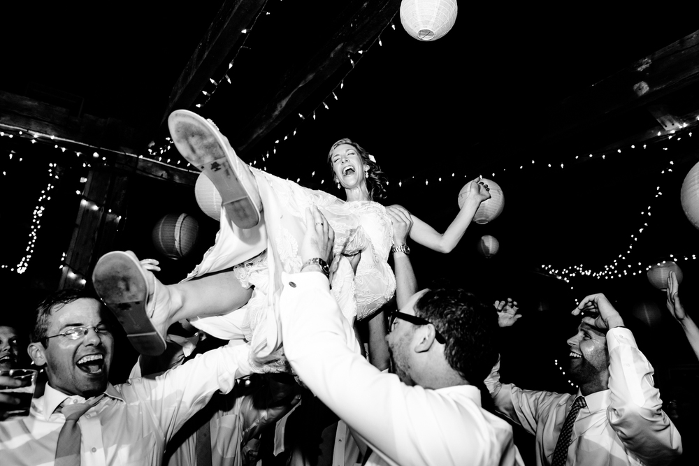 Bride get's lifted up on the dance floor.