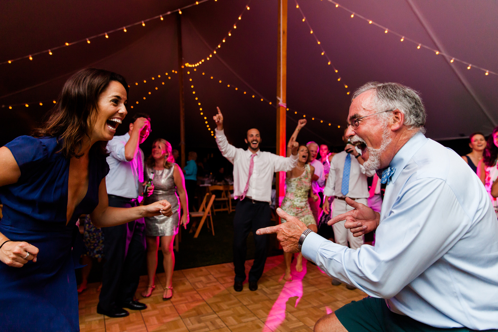 Guests dance at wedding reception.