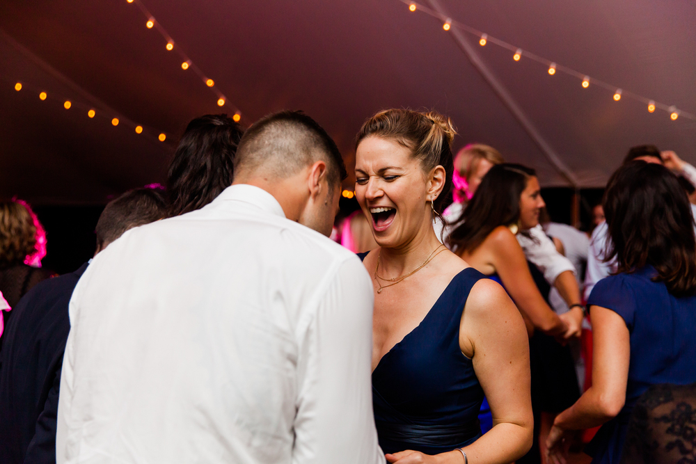 guests dance at wedding.