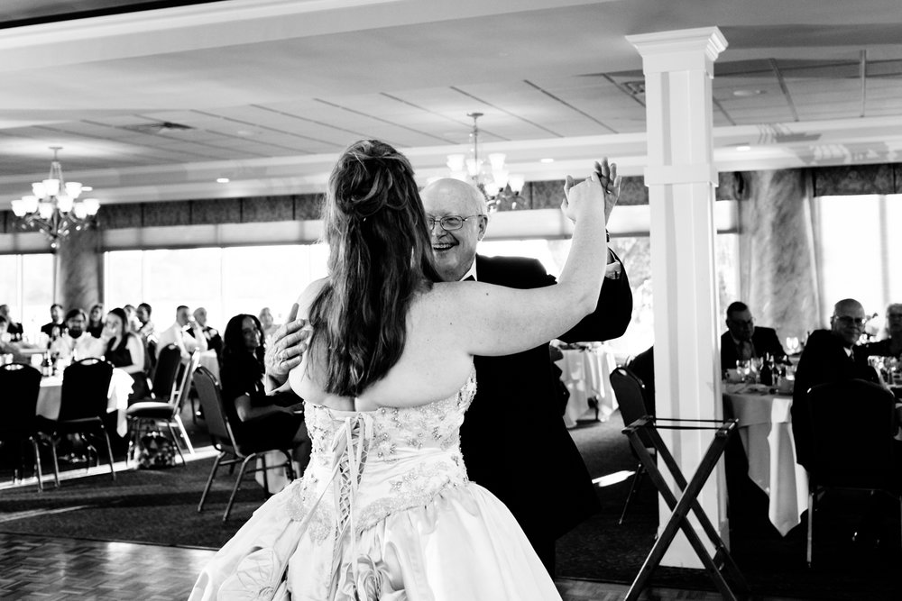 Black and white image of the bride and her father sharing a dance together.