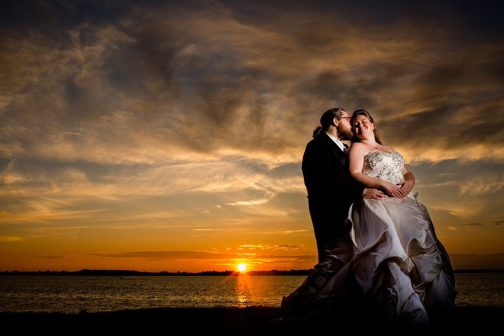 Bride and groom sunset image.
