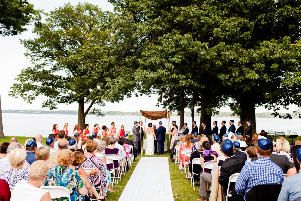 Bride and Groom get married with a lake in the background in Geneva, NY.