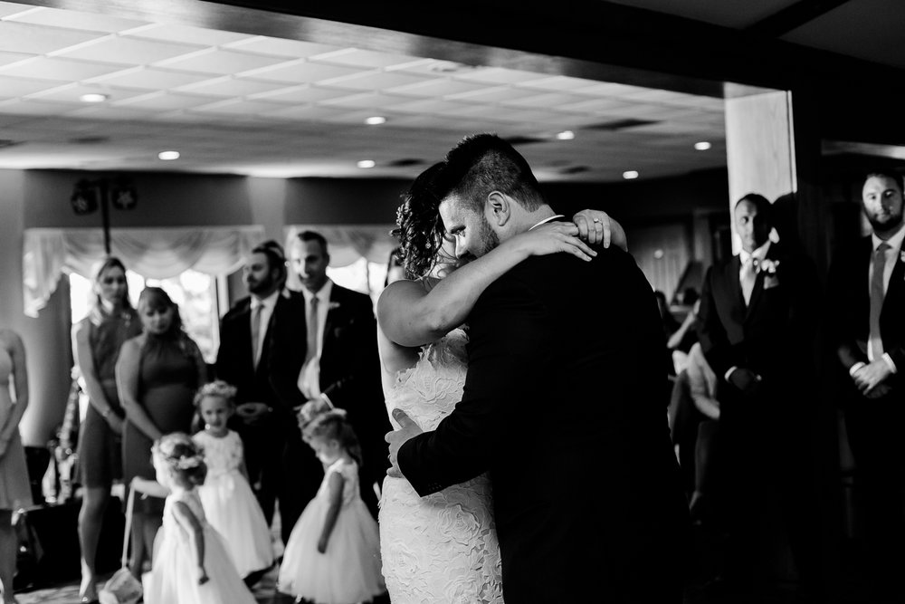 Black and white image of bride and groom during first dance.