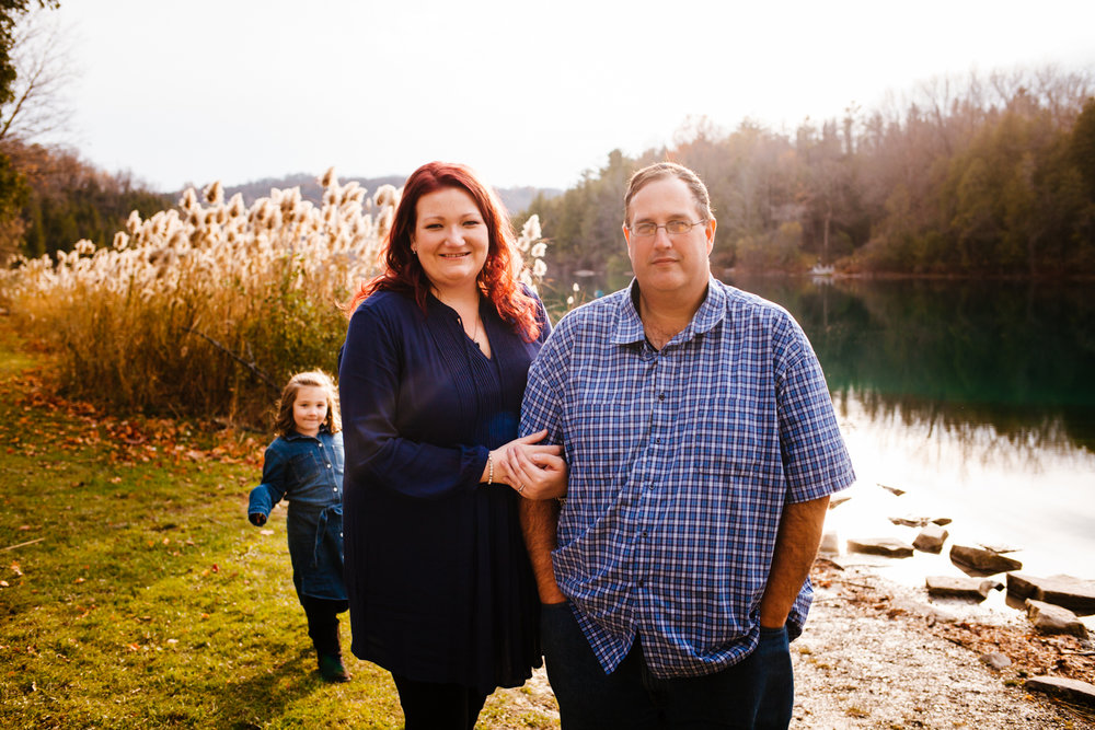 Young girl photobombs her parents during their engagement shoot at Green Lakes State Park.