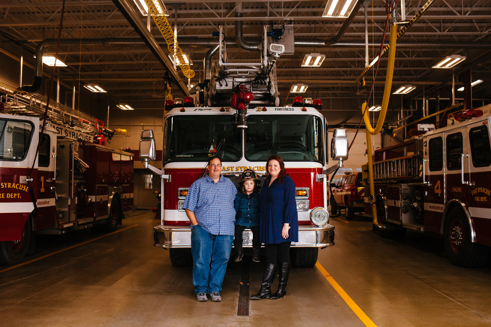 Family portrait in a fire station.