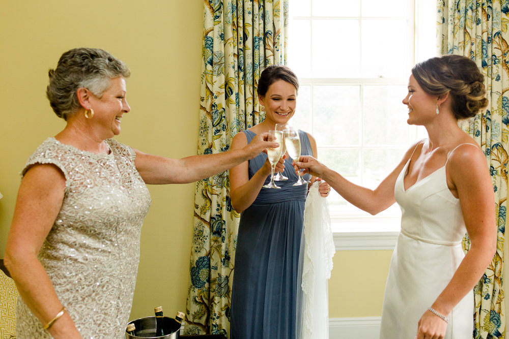 Bride, sister, and mom share a toast at the Otesaga Resort in Cooperstown, NY.