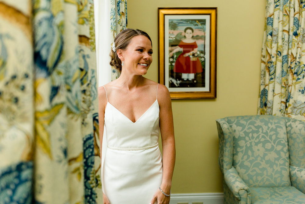 Bride smiles before her wedding ceremony