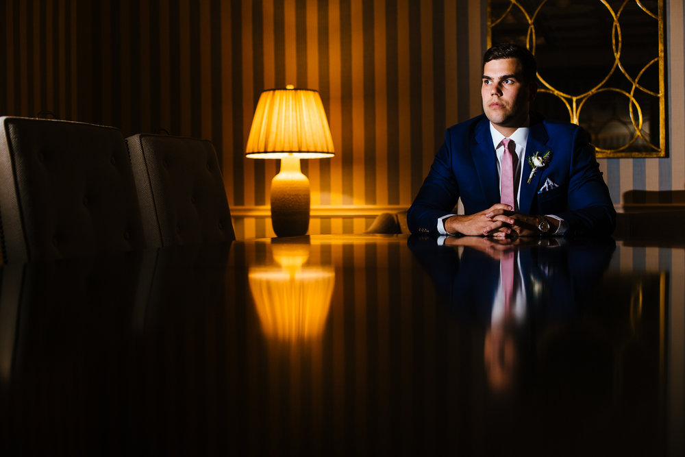 Moody portrait of groom at the Otesaga Resort in Cooperstown, NY.