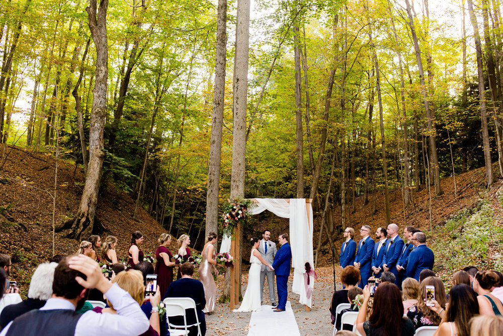 Bride and groom during their ceremony at New Park Retreat in Ithaca, New York.