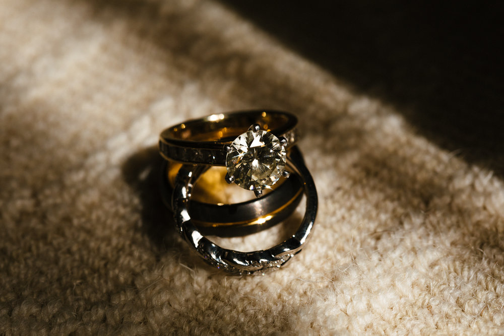 Engagement Ring and Wedding Bands. Photo by Syracuse wedding photographer Calypso Rae Photography.