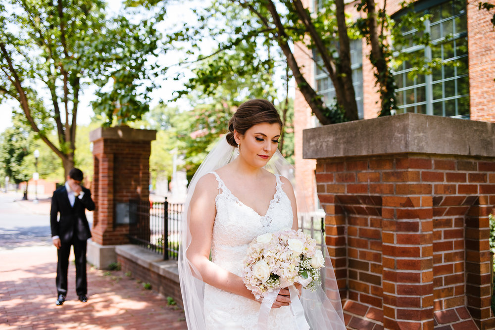 First look with bride and groom in Franklin Square Syracuse, NY. Photo by Calypso Rae Photography