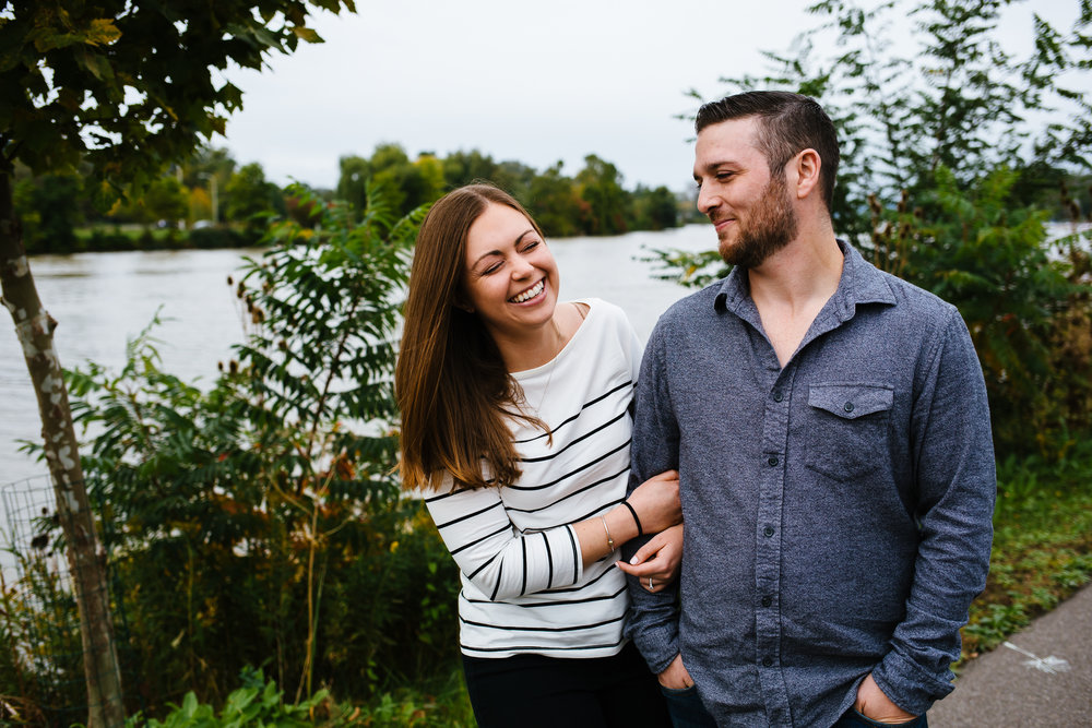 Ithaca Farmer's Market Engagement Session. Female is holding the mans arm laughing.