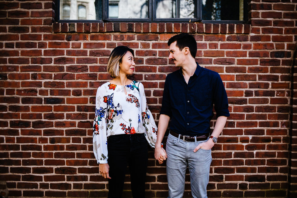 Engagement session in New Haven, Connecticut. Couple in front of bricks.