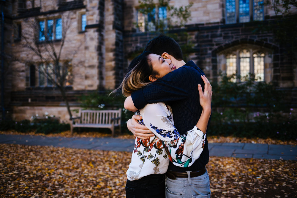 A man and woman embrace on the quad of Yale University.
