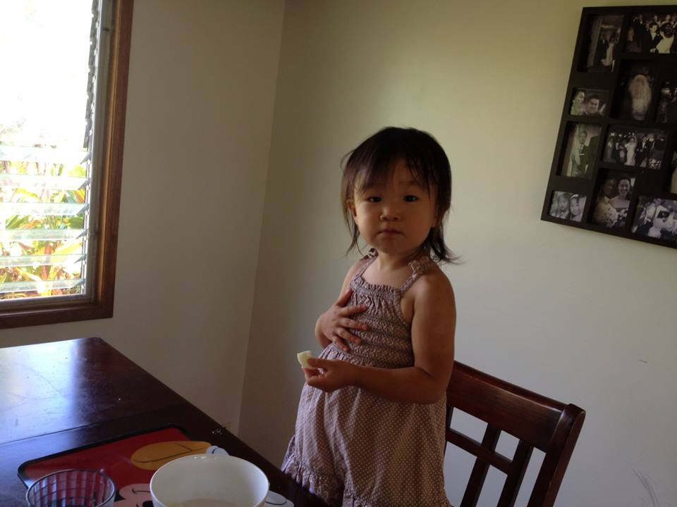 My little hobbit eating egg whites and oranges... her second breakfast. She looks like she's ready to sing a verse.