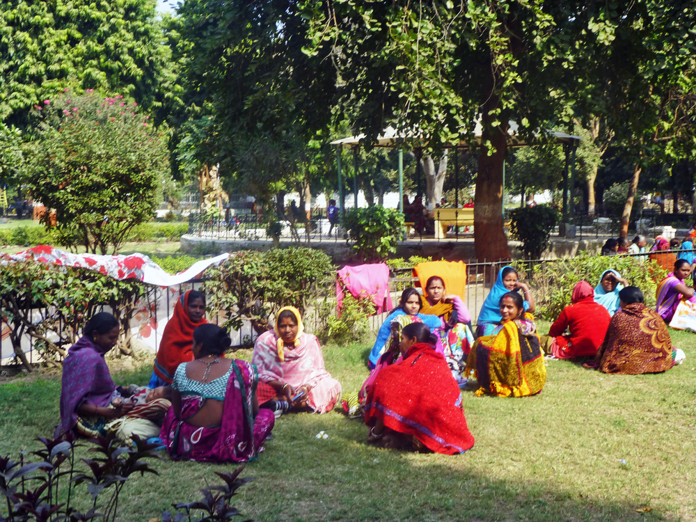 A group of women having a meeting in Victoria Park on a Sunday