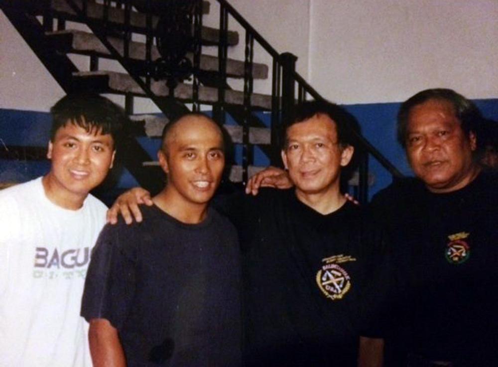 From the Cincinnati Balintawak Club days, Elmann Cabotage (2nd from left) with Grandmaster Jorge Penafil and Grandmaster Bobby Taboada