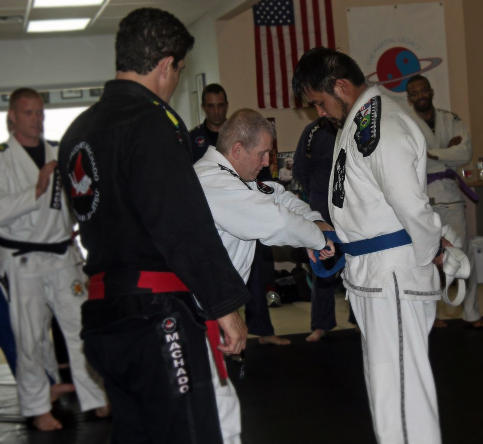 Guro Michael receiving his Blue Belt in Brazilian Jiu Jitsu in 2014