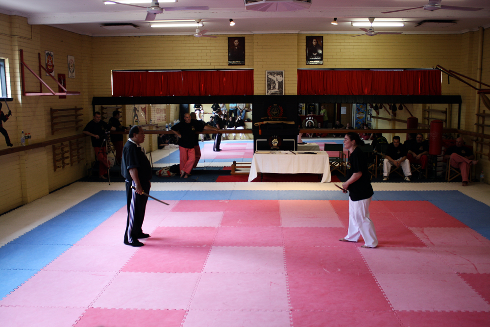 Guro Dicker looks on as Grand Master Taboada test his student, Guro Monique Brasher, during her FQI Test in 2009.