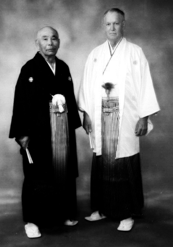 L-Taika Seiyu Oyata (1930-2012) R-Tasshi Jim Logue (1947-2011)