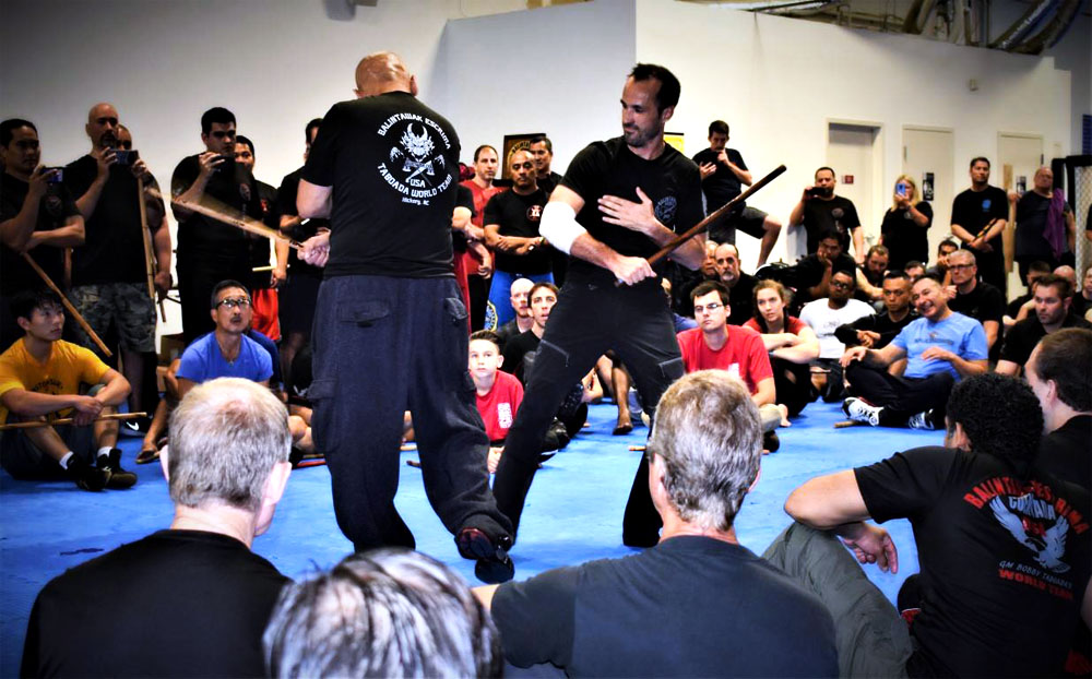 Guro Sanchez helping GM Taboada demonstrate technique at the 2018 World Camp in Charlotte NC