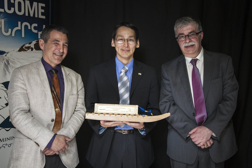 L-R: Hunter Tootooo (Canadian North) Ronnie Suluk (Arviat, receiving on behalf of Keith Collier, EDO Arviat) and Bernie MacIsaac (Nunavut Mining Symposium Society).