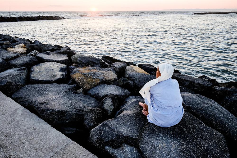 Praying nun near the sea.jpg