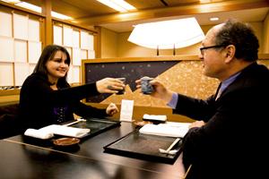Emmi and Alexei toast at the Kitano