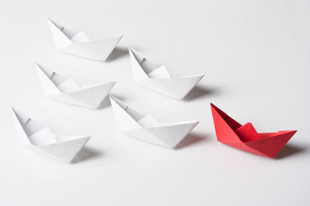 leading-paper-boats.jpeg