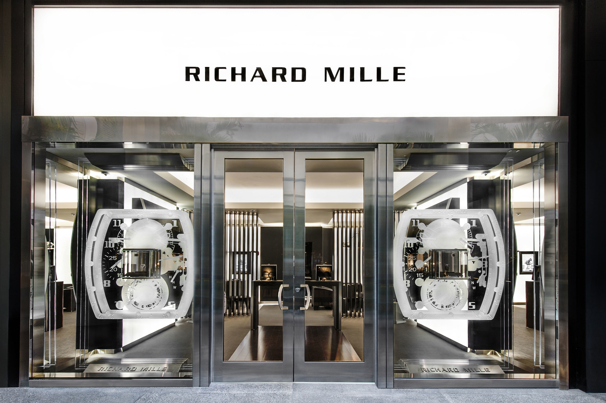 Two triple-pane glass sculptures in the shape of Richard Milleu0027s iconic tonneau watch flank the front door of the new boutique. & RICHARD MILLE OPENS THIRD BOUTIQUE IN AMERICA AT THE BAL HARBOUR ...